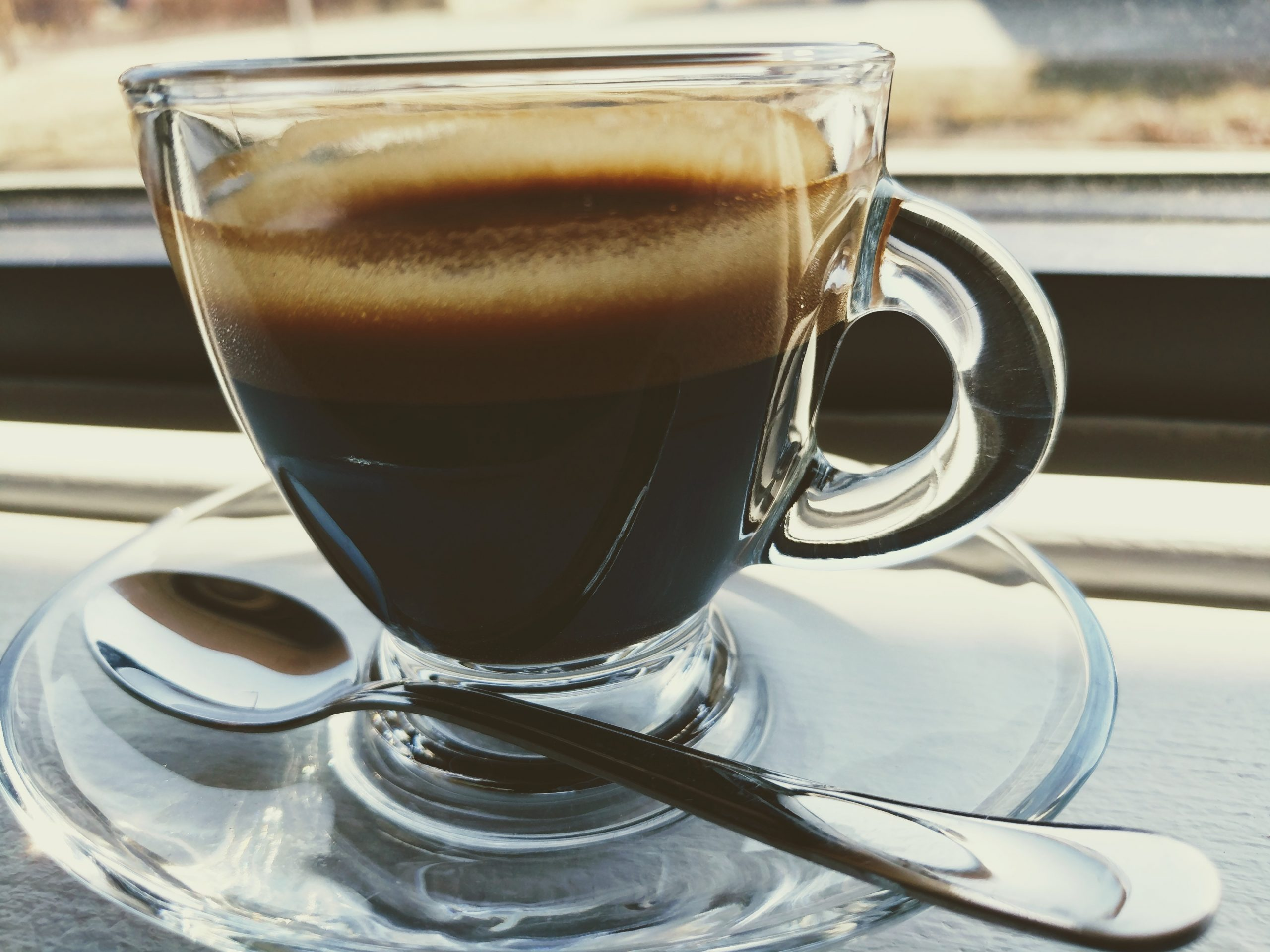 Cup of espresso with spoon and saucer